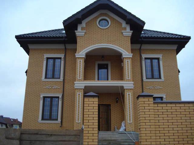 Отделка фасада частного дома фото
